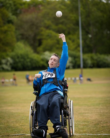 Special Olympics Norfolk wheelchair athlete, Kevin Threadgold, competing in softball throw. Picture: