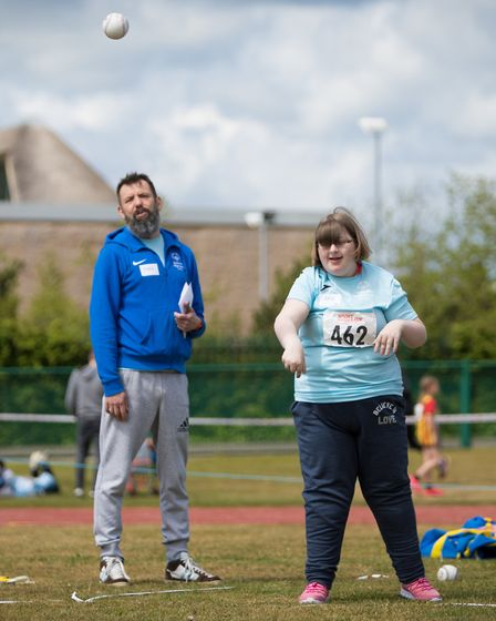 Katie Warrent taking part in softball. Picture: Michael Lyons
