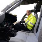 The Duke of Cambridge sits in the cockpit of a helicopter as he begins his new job with the East Ang