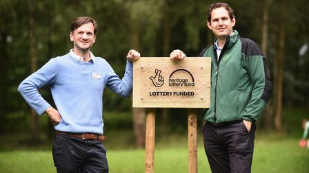 The Forestry Commission has been given a grant of £610, 300. Pictured unveiling the plaque at High L