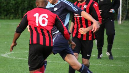 Cromer Town manager Jordan Kemp, pictured right in action against Buxton, is confident his side will
