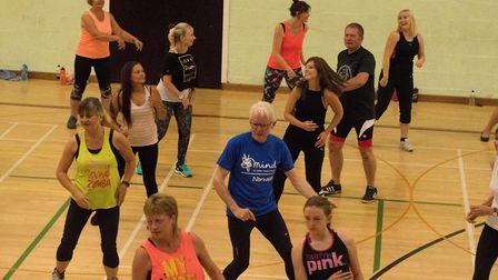 North Norfolk MP Norman Lamb takes part in the Zumba fitness session at North Walsham Sports Centre.