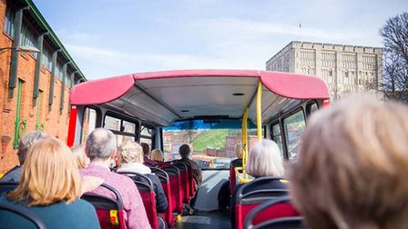 Guests on the open top bus tour approach Norwich Castle. Picture: Richard Jarmy Photography