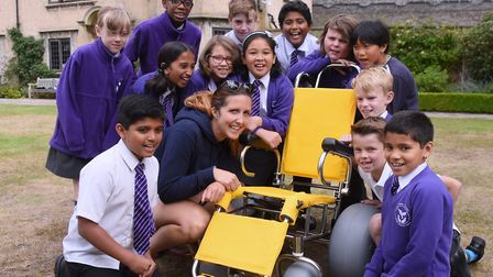 Children from the St Francis of Assisi RC School at How Hill with Lizzy Ames, education manager, and