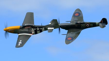 A P-51 Mustang (left) and Spitfire MkIX performs at the Old Buckenham Airshow.Picture: Simon Parke