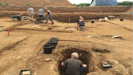 Volunteer archaeologists digging trenches in Sedgeford to uncover the history of the village's past.