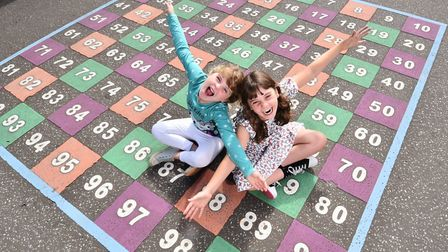 Tessa, 7, and sister Rachel Deane, 9, celebrate the launch of Count on Norfolk summer maths activity