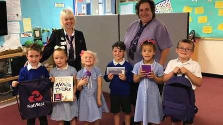 NatWest's Kate Jones and Yvonne Howard present school starter packs to pupils at Wroughton Infant Ac