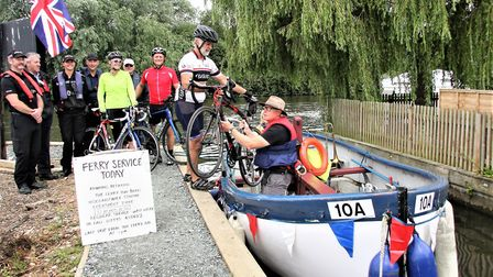 Broads Rangers, Broad Beat and supporters with the first cyclists on the ferry. Picture Maurice Gray