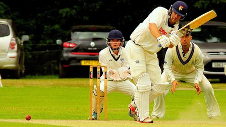 Rob Taylor in full flow during the final day of Norfolk's Minor Counties Championship match against