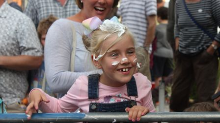 Seven-year-old Maddy Fisher watching Sheringham Carnival street races. Picture: KAREN BETHELL