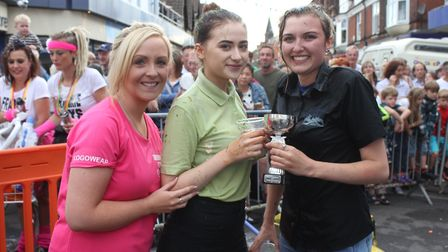 Carnival queen Abigail Dowsett-Olby presenting the waiters and waitresses' race trophy to Emily Oakl