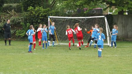 The Red Rose U11s team scoring the opening goal from a corner in a 2-1 cup victory against Taverham.