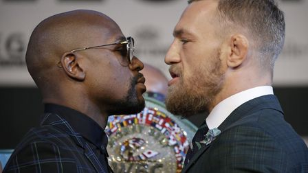 Floyd Mayweather Jr., left, and Conor McGregor will fight in Las Vegas on Saturday. Picture: AP PHOT