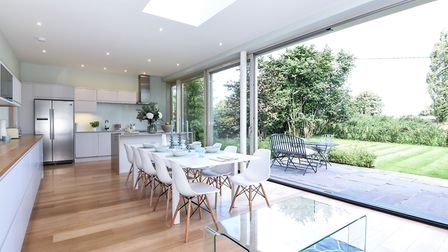 The large integrated inner sliding doors open on to the garden. Picture: courtesy of Sowerbys