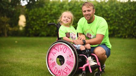 Daisy Mason (6) and her dad Adam are taking part in a Superhero Series triathlon this weekend at Dor