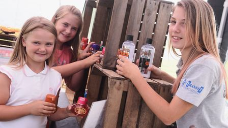 Sisters Vicky, nine, Angelica, 11, and Frankie Davies, 12, set up their family's stall for this year