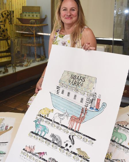 Artist Vanessa Burroughes with her artwork inspired by the 19th century Noah's Ark in the toy room a