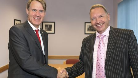 Gibbs Denley director Paul Gibbs, left, with One Broker Group chief executive Robin Plaster. Picture