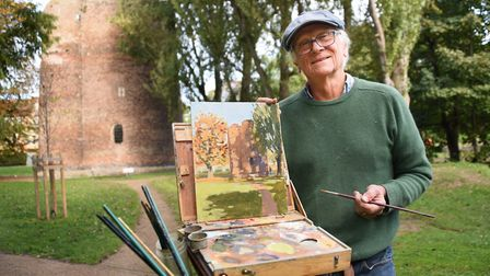 Artist Robbie Murdoch at work at Cow Tower during the Norwich Paint Out. Picture: DENISE BRADLEY