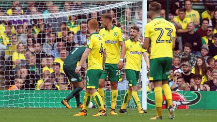 The Norwich players look dejected after conceding their side's 1st goal during the Sky Bet Champions