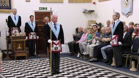 The director of ceremonies calls the brethren to order before the officers enter the temple at the W