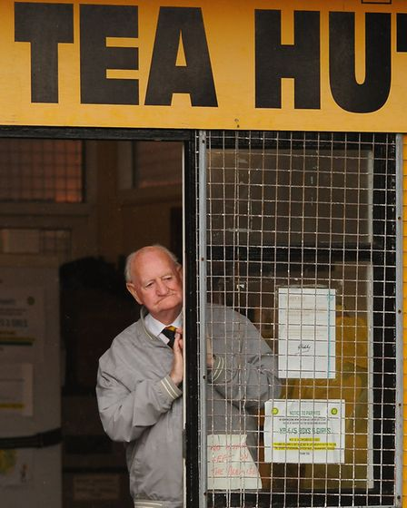 Eddie Hanton, who has been watching Great Yarmouth play since 1947, stays in the dry of the Tea Hut