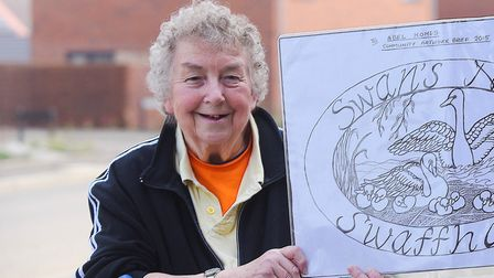Patricia Howe with her entry into a competition to design a sign for a housing development in Swaffh