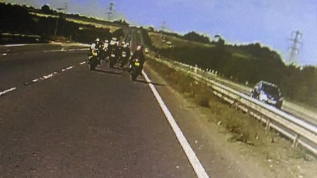Police said the three men and two women were stopped by an officer on an unmarked police motorcycle
