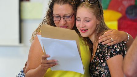 Students from Sir John Leman high school collect GCSE results.Grace McGregor sharing her results wi