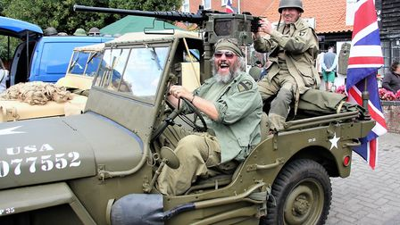 Vintage jeep on display with Roger Hodds at wheel and Tracey Thompson at Stalham vintage and collect