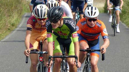 The final split opens up – Norwich rider Tommy Power (in green) to the fore. Picture: Fergus Muir
