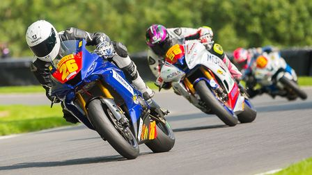 Grant Newstead leads Cameron Lee in the Superstock 600. Picture: Barry Clay