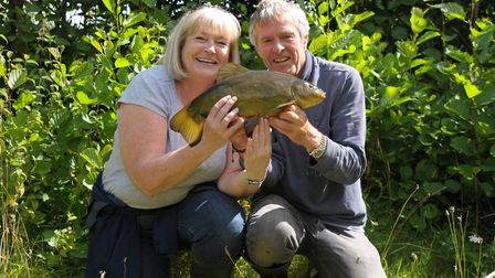 John Bailey and Ruth with a much-prized tench. Picture: John Bailey