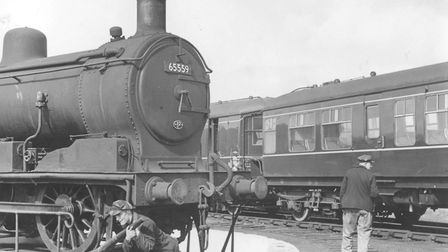 Alec Tuck was pictured apparently putting his back into operating the former Wells station turntable