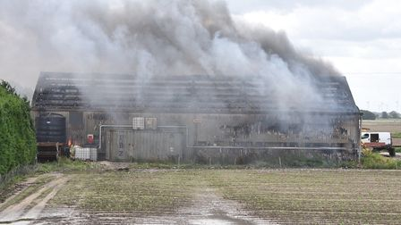 Fire at a barn on the outskirts of Wisbech today. Picture: Ian Carter