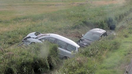 The two cars in the ditch on the Acle Straight. Picture: George Ryan