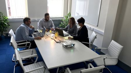 The Time4Advice team at work in a St George's Works meeting room. Picture: Jayne Cronin