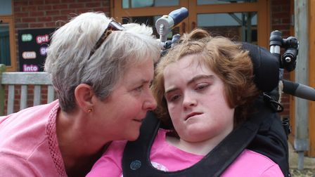 Sarah Dewhurst with 14-year-old Alice, who has profound and multiple disabilities. Picture: KAREN BE