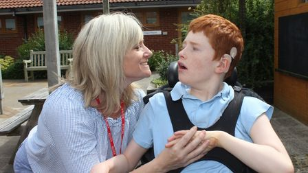 Sam Wheeler of Dereham with 12-year-old son Kian, who is deaf blind and has global developmental del