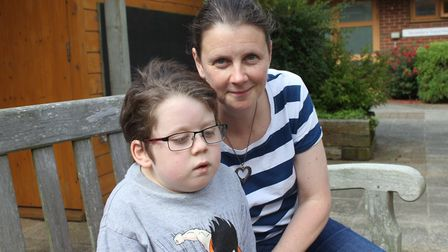 Lisa Harvey with son Daniel, 10, who will be receiver fewer hours residential respite care as a resu