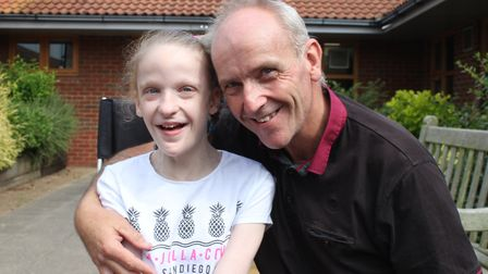 Single dad of three Michael Regan with eleven-year-old Maddison, who has Mowat Wilson syndrome. The
