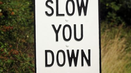 """The """"Slow You Down"""" speed signs that can be found at either end of the village of Wiveton,. PHOTO;"""