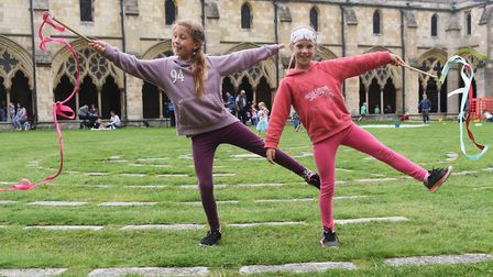 Sisters, Amber, nine, and Briony, seven, try out the ribbons at the Norwich Cathedral Fun Day. Pictu