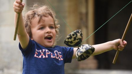 Zachary Hinchliffe, three, plays with a diablo, at the Norwich Cathedral Fun Day. Picture: DENISE BR