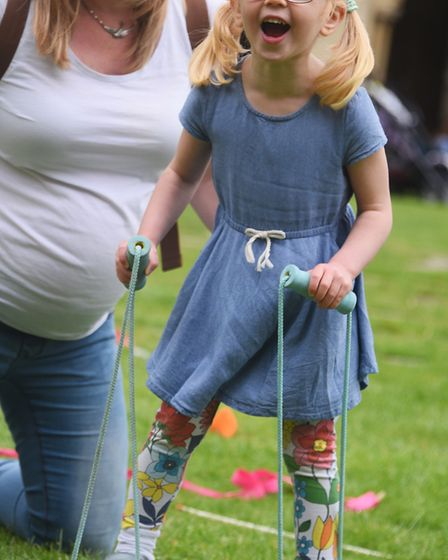 Eve Walkeden, three, enjoys the Norwich Cathedral Fun Day with mum, Sarah. Picture: DENISE BRADLEY