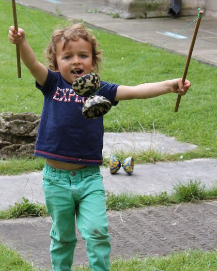 Zachary Hinchliffe, three, plays with a diablo, at the Norwich Cathedral Fun Day. Picture: CHARLOTTE