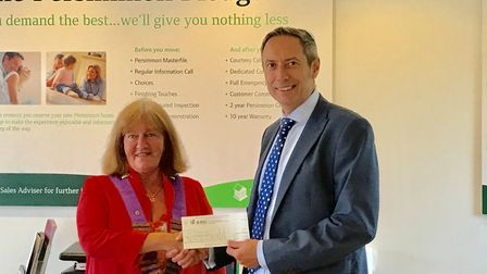 Persimmon Homes Anglia managing director Andrew Fuller presents a cheque for £1,000 of Community Cha