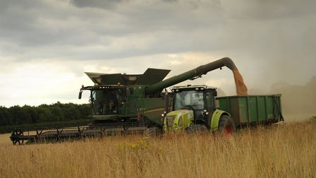 Combine harvesters at work in the fields near Framsden. Picture: SARAH LUCY BROWN