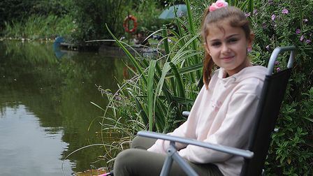 A young angler enjoying the day. Picture: Chris Bishop